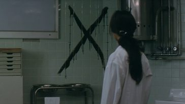 A woman looks at an X in a hospital room