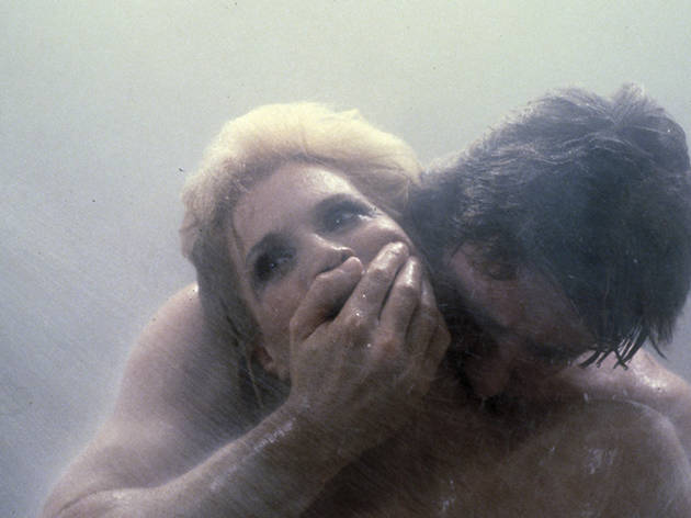 A middle-aged woman is seized by a man in the shower.