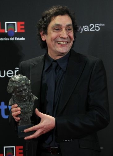 Augusti Villaronga smiling with an award trophy