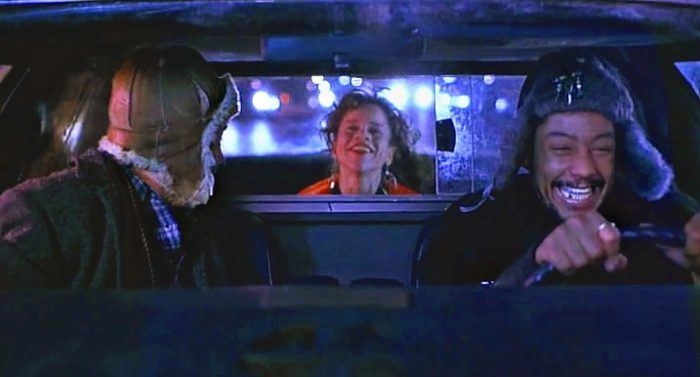 Cab driver YoYo (Giancarlo Esposito) and Helmut (Armin Mueller-Stahl) entertain Angela (Rosie Perez) in New York