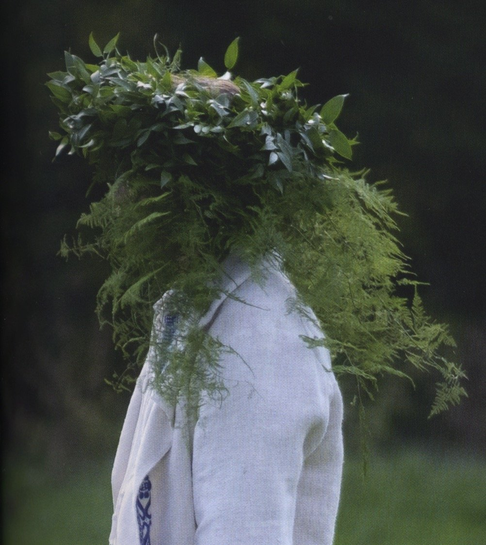Pelle the Green Man with a headdress of green foliage