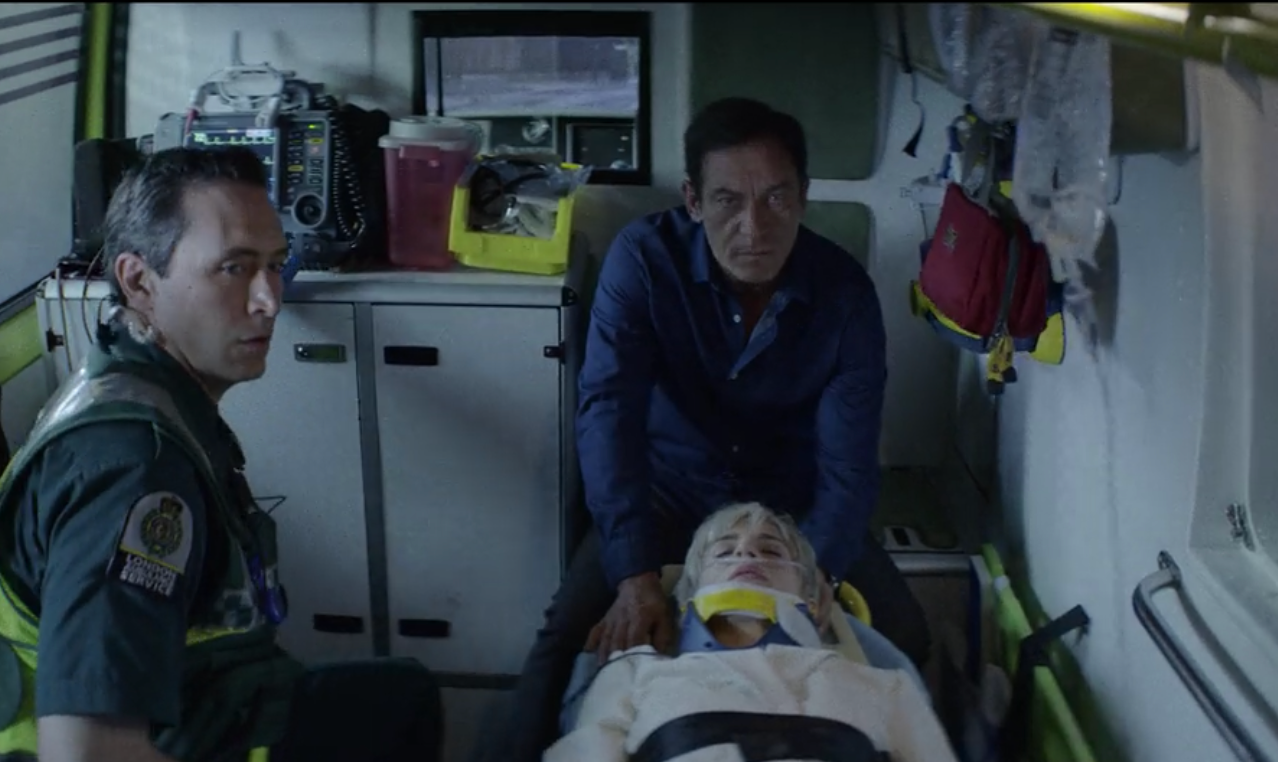 Jason and Brit in the ambulance