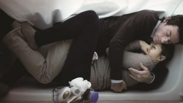 Shane Carruth and Amy Seimetz embrace in a bathtub in Upstream Color