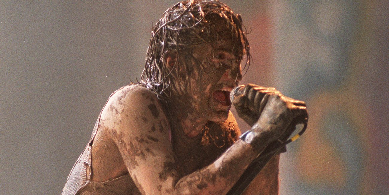Nine Inch Nails' Trent Reznor beyond muddy while performing at Woodstock '94
