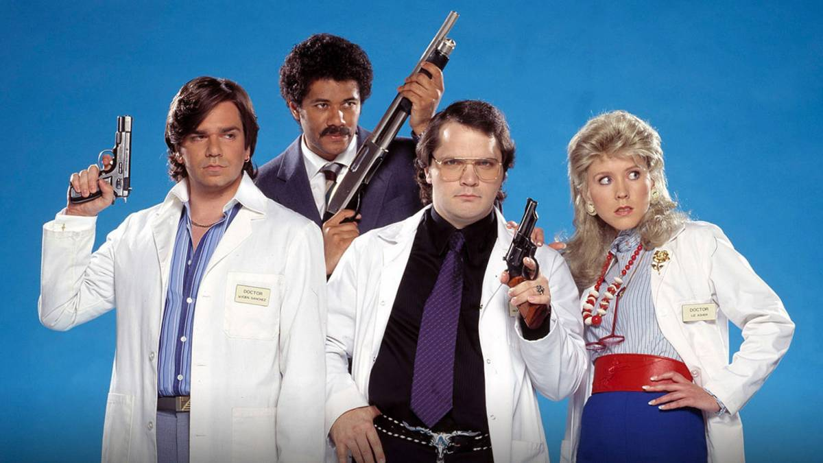 Principal cast pose with weapons in Garth Marenghi's Darkplace