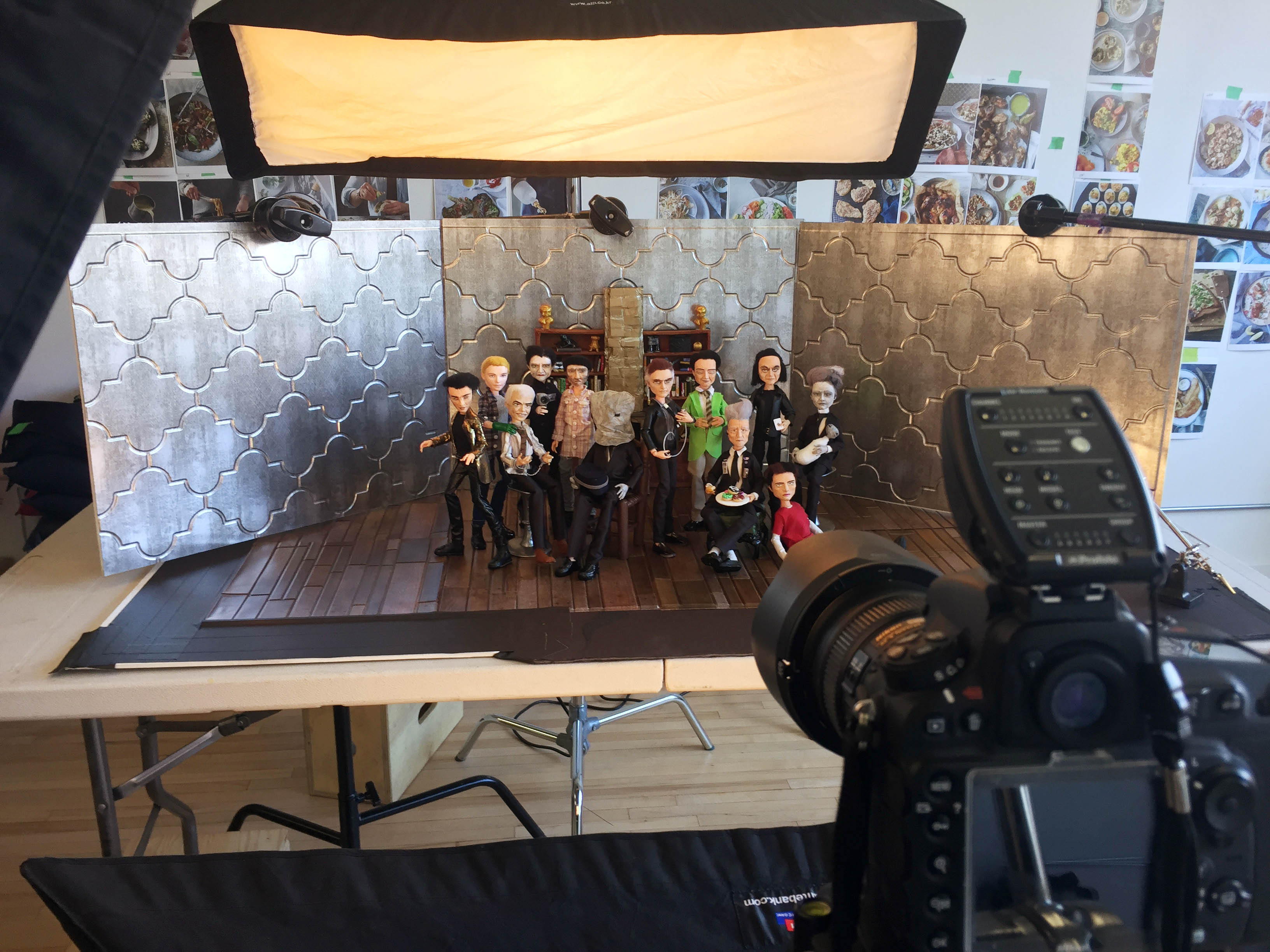 The Men of Lynch dolls being photographed by Blake Morrow
