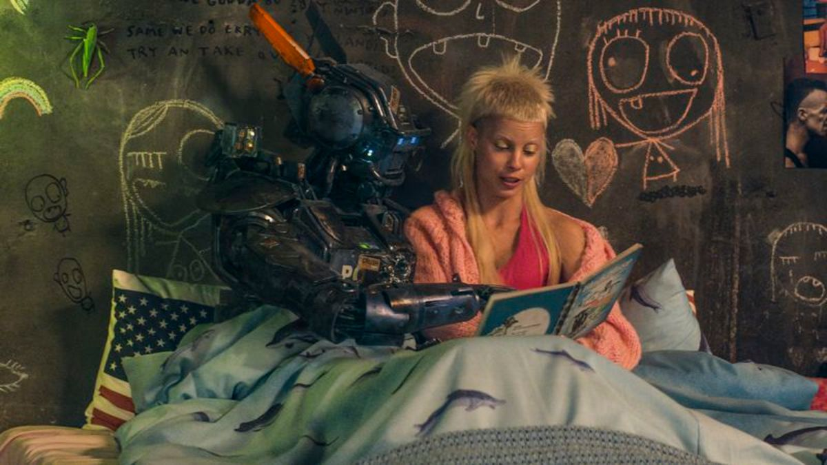 Yolanda reads Chappie his book, The Black Sheep, as they sit in bed together.