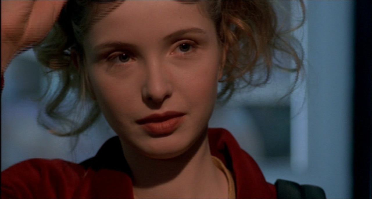 Julie Delpy in Killing Zoe with blonde hair and red jacket
