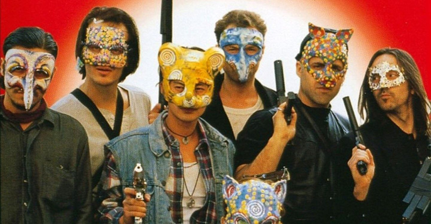 The bank robbers wearing masks and holding guns