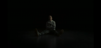 David is in a straight-jacket with an all black background