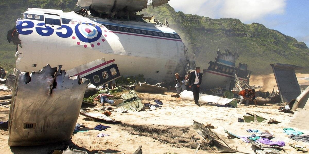 Jack stands in front of the wreckage of the plane on the beach in the pilot episode of Lost