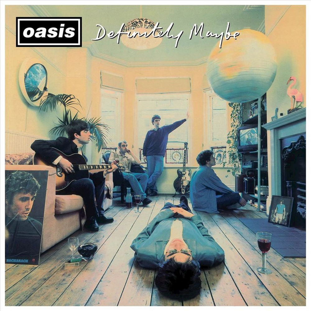 The Oasis band members sit in a flat as if they're in between writing songs on the cover of Definitely Maybe.