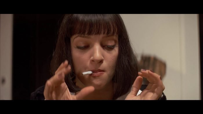 Mia Wallace smokes a cigarette