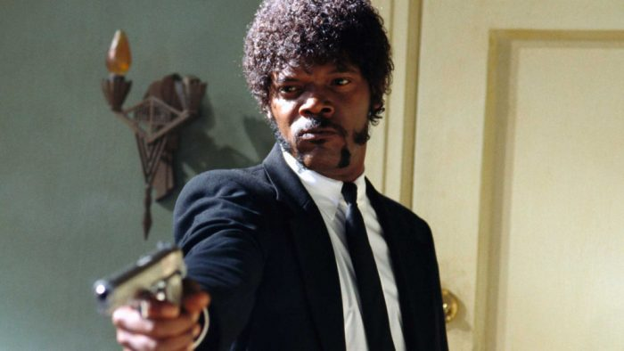 Jules (Samuel L. Jackson) stares down Brett with a gun in his hand