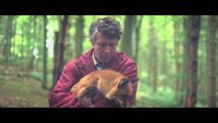 "Aiden Gillen holds a fox in the video for Sigur Ros's ""Ekki Mukk"""