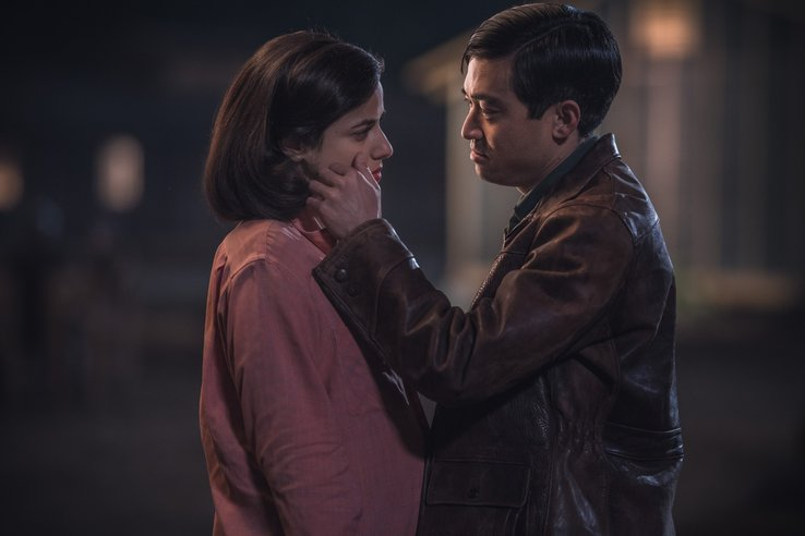 Chester and Luz face each other outside in the dark, as Chester strokes Luz's cheek