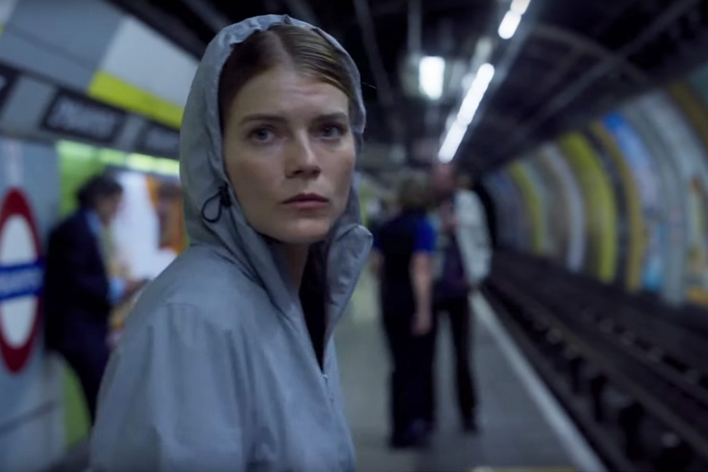 Myfanwy is hiding in the subway wearing a poncho.