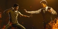 Two men fight in a promo image for Wu Assassins