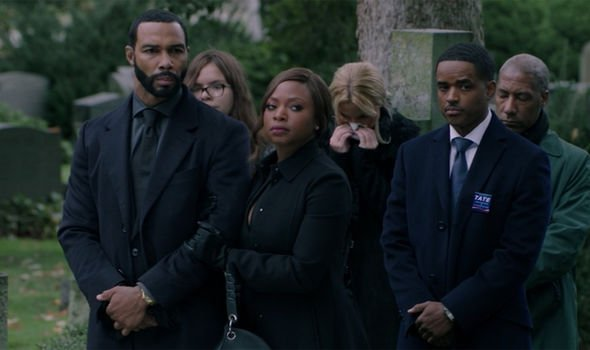 Tasha holds Ghost's arm at Angela's funeral as Councilman Tate stands next to them with his hands folded