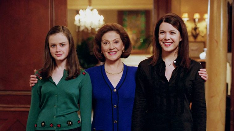 Emily puts her arms around Rory and Lorelai