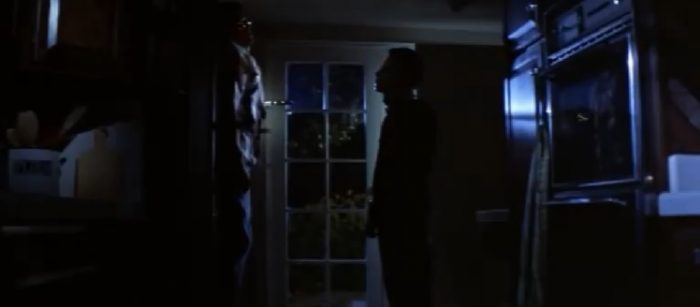 Micheal stares at Bob, who is hanging dead, pinned to the door with a large kitchen knife.