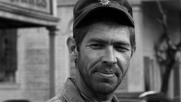 James Coburn looks at a starving community in The Old Man In The Cave