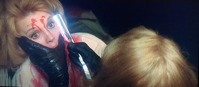 Kate Miller (Angie Dickinson) has her face slashed in an elevator in Dressed to Kill.