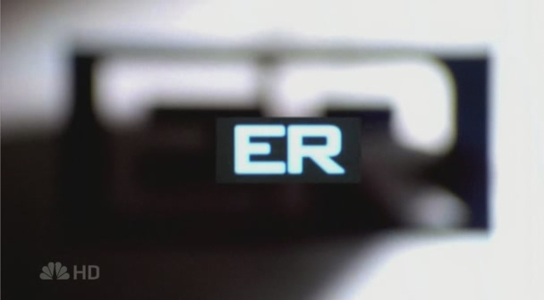 the ER title card, gray background with capital boldface letters ER in the center.