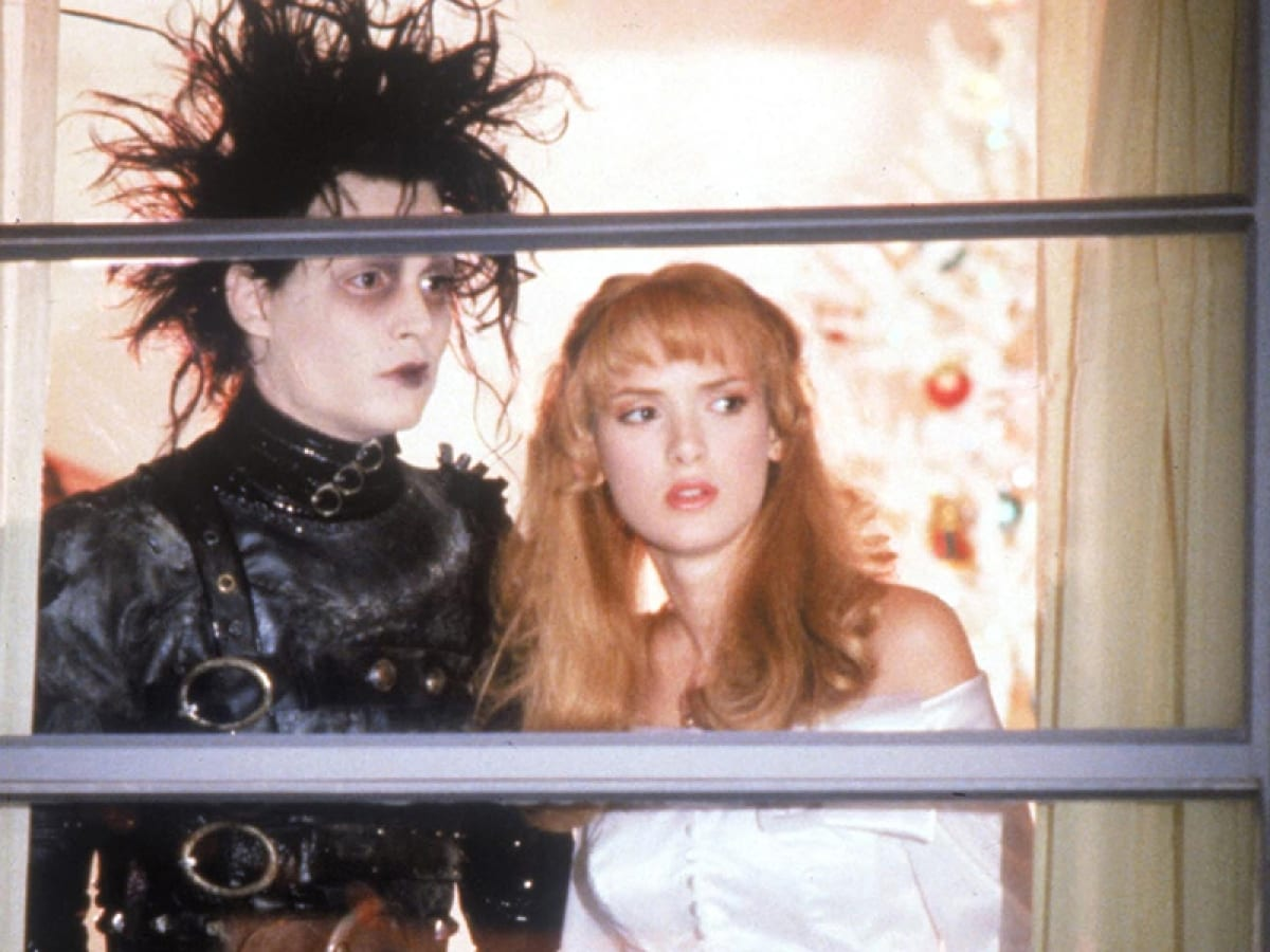 Edward and Kim look out of a window