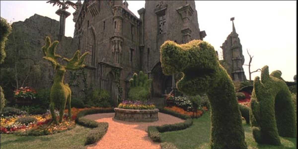 The Castle of Edward Scissorhands with topiary animals in the front garden
