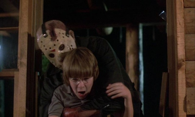 Jason grabs Tommy played by Corey Feldman from behind