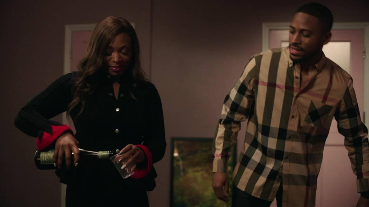 Tasha pours wine next to Quinton