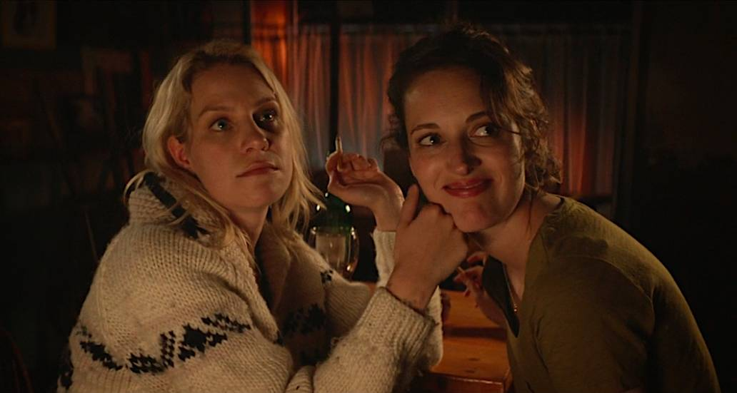Boo touches Fleabag's face as they share a quiet moment in the cafe