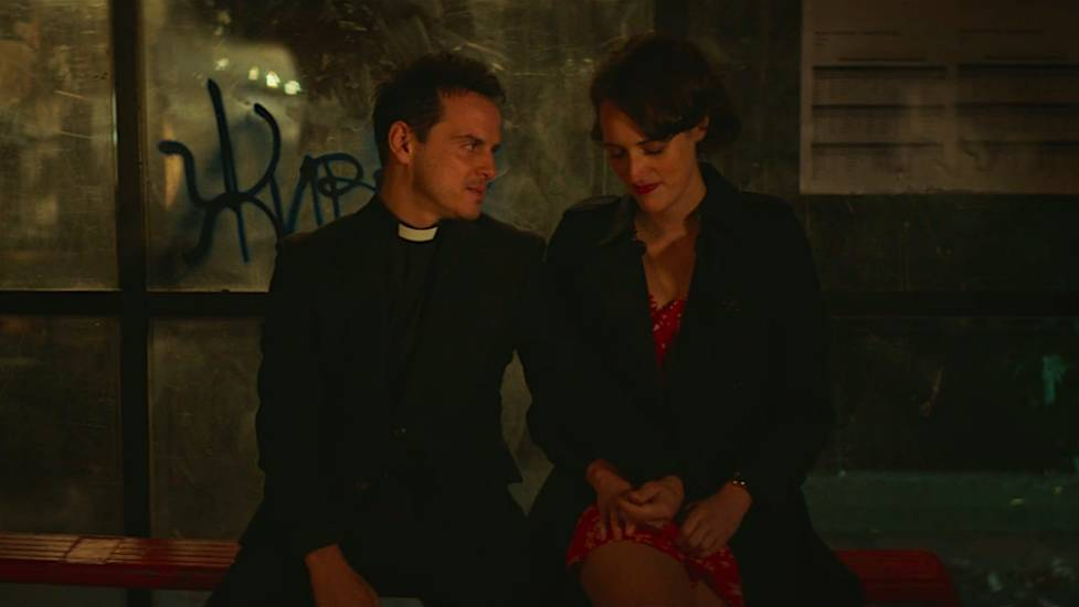 Fleabag and The Priest sit at the bus stop after she tells him she loves him
