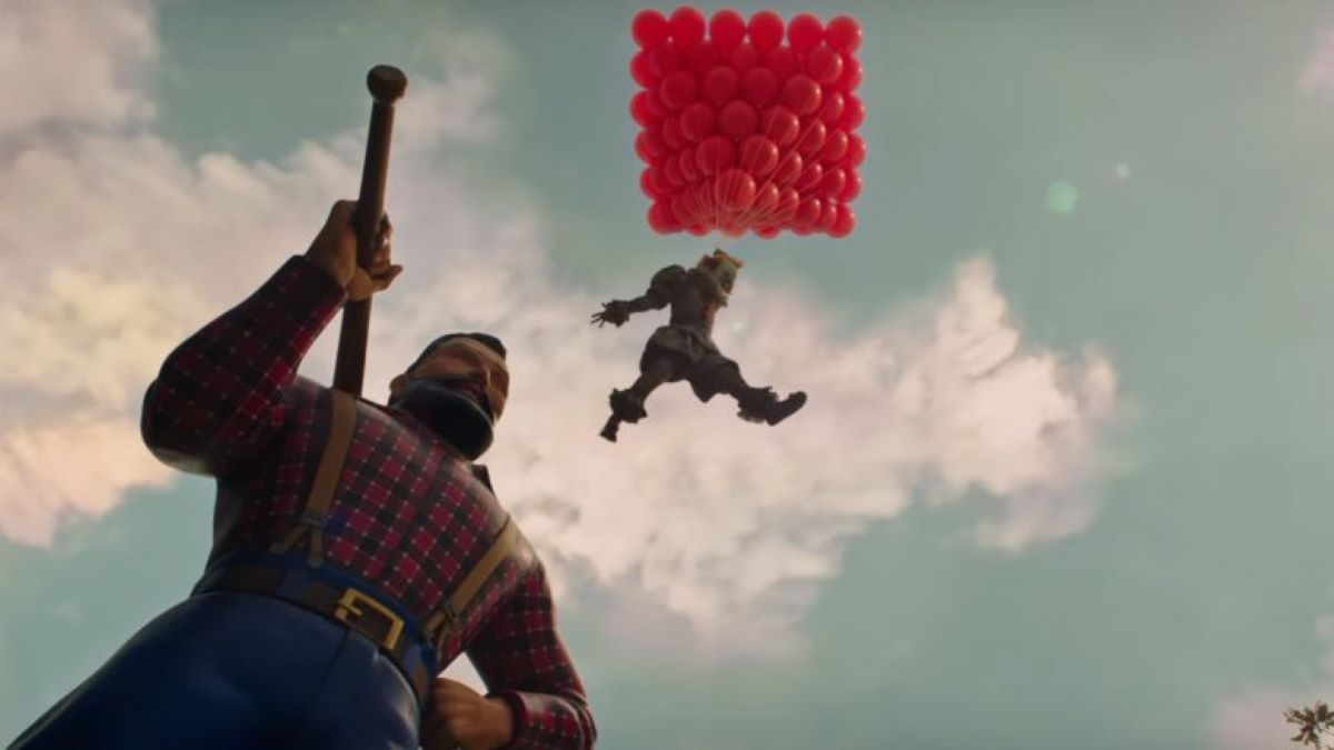 A creepy clown holds on to red balloons and floats in the sky over a statue.