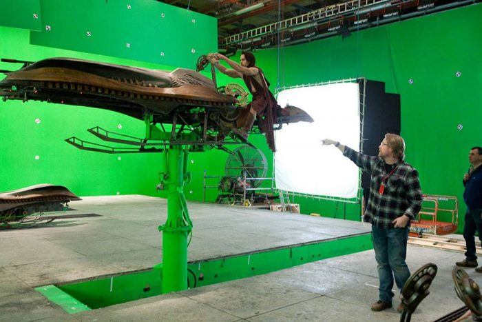 Director Andrew Stanton gives Taylor Kitsch guidance on the green screen stages.
