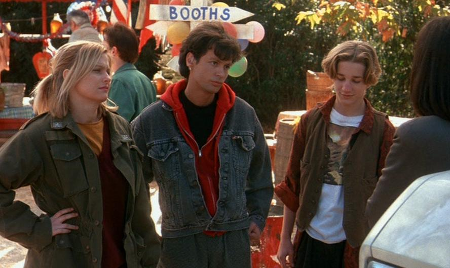 Tracy (Lezlie Deane), Carlos (Ricky Dean Logan), and Spencer (Breckin Meyer) attend a carnival of only adults in a scene from Freddy's Dead.
