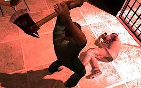 The main character performs an axe execution on a man laying on the floor.