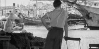 Marius looks out at the ships in the harbor