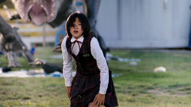 Hyun-seo frozen in terror with the monster behind her.