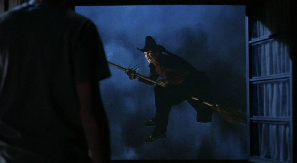 Freddy Krueger (Robert Englund) reenacting the Wicked Witch's tornado appearance from Wizard of Oz in Freddy's Dead.