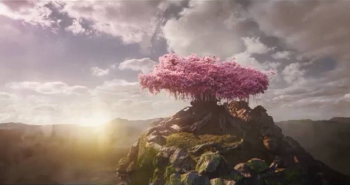 The Sactuary Tree, a very old tree with pink leaves, sits high on a mountain top as a new dawn arises.