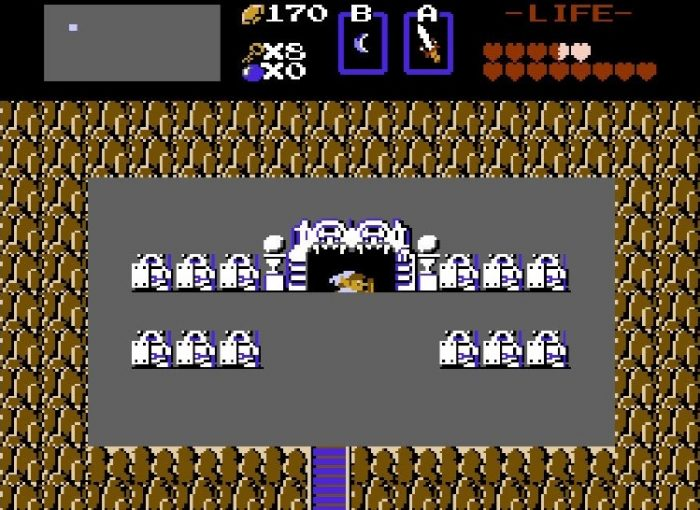 Link descends a stairway of a dungeon in the shape of a monster mouth.