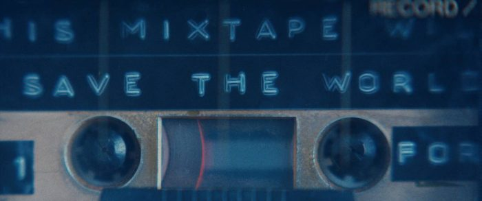 A cassette mixtape left by Grace plays containing music capable of thwarting an invading alien threat.