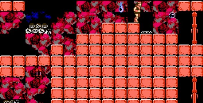Simon stands on a pile of orange blocks being burned away by acid. Two doors are at the other end. One will require a bit more patience.