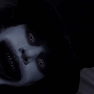 the face of the babadook with a massive black grin