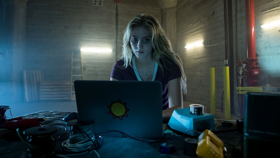 Alice sits at her laptop in a dark room in Bedeviled