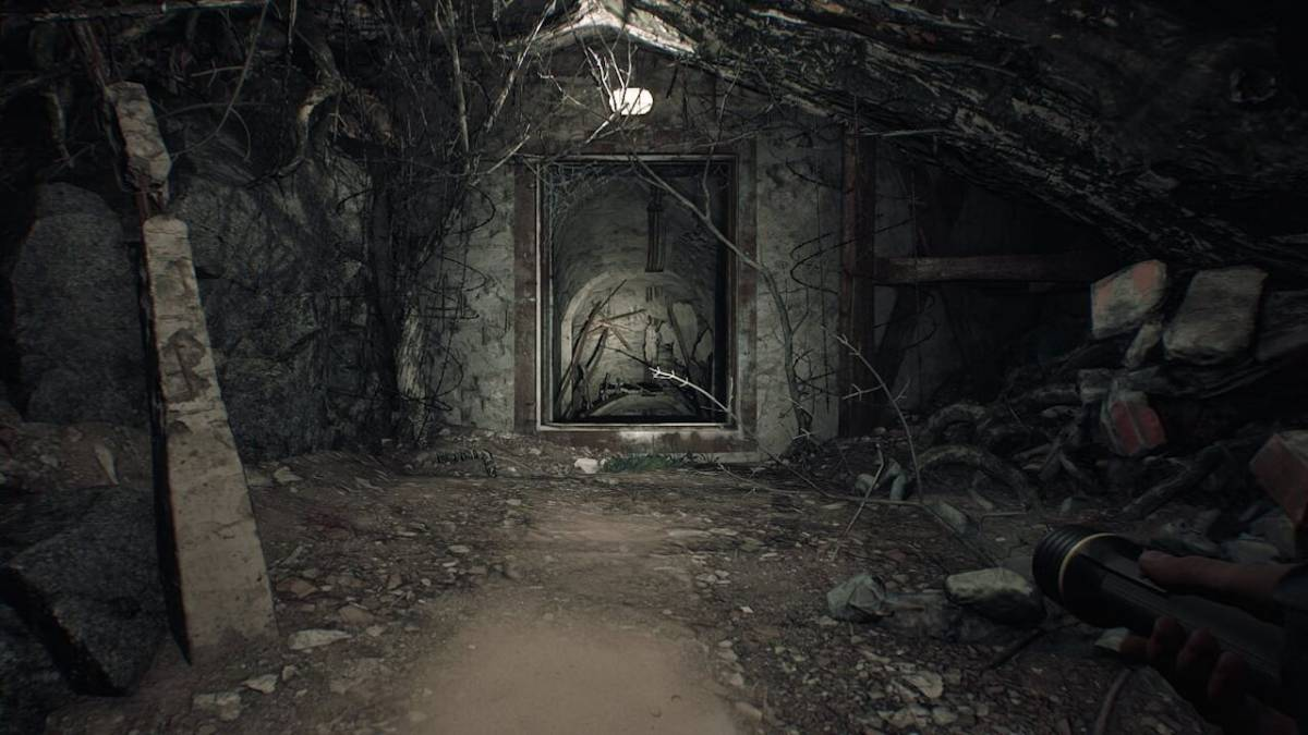 A creepy looking doorway filled with debris and tree branches