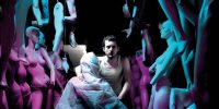 Frank (Elijah Wood) sits amongst his mannequins in a dramatically lit promo shot