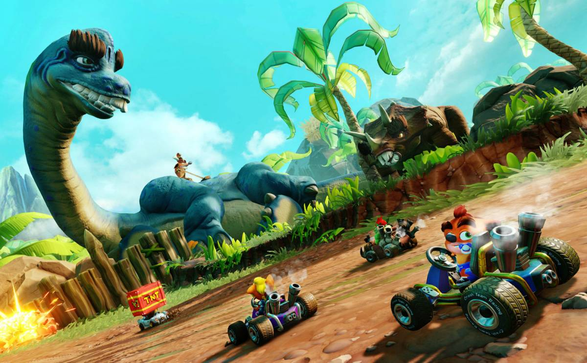 The Crash Team racers drive past a dinosaur